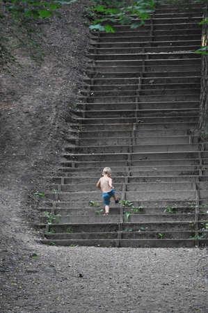 A boy climbing upstairs Stock Photo - 7688153