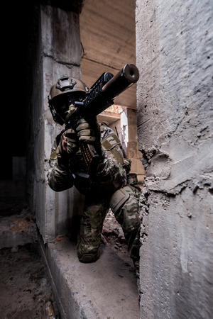 extremist: Russian army soldier shoots a machine gun out of hiding in an abandoned building