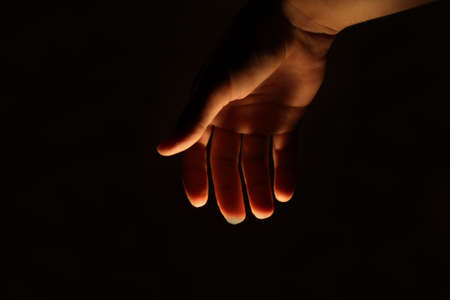 lighted: human man hand lighted from beneath