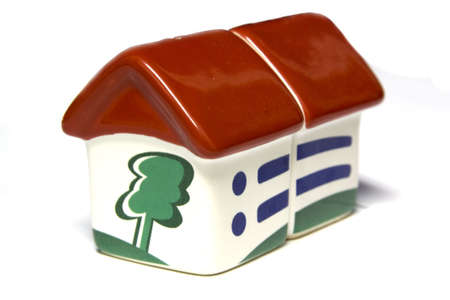 miniature house with red roof on white background Stock Photo - 6719717