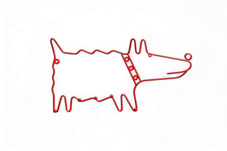 metal red dog hanger on white background photo