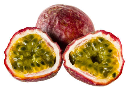 two halfs of passionfruit an a whole one photo