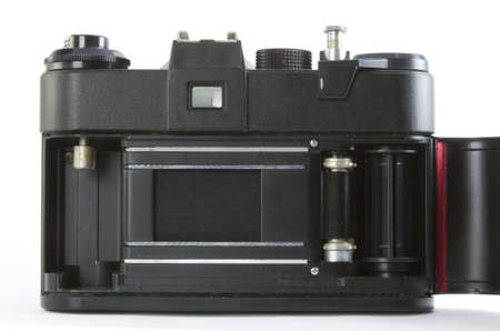 old film camera with opened back side photo