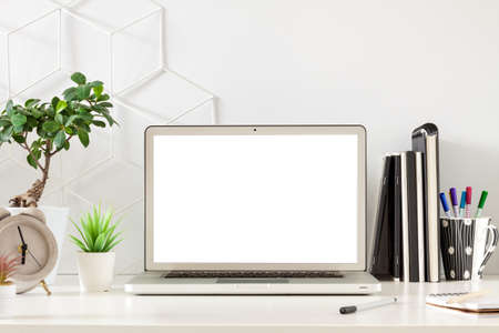Open laptop with screen mockup. Business desk.