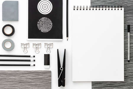 Flat lay mockup with black frame and office supplies on white background. Top view mockup. Blog template. Black and white concept