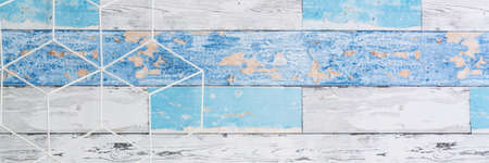 A wall with old boards. Geometric toolbox. Copy space. Panorama. 免版税图像