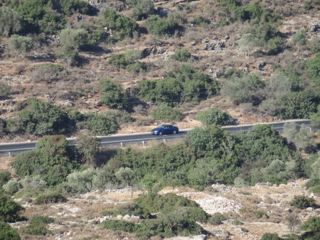 A car drives on an isolated road in the Shomron Mountains Stock fotó