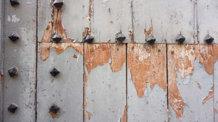 close up of deteriorated wooden door with rusty nails Stock Photo