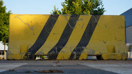 jersey cement barrier painted yellow