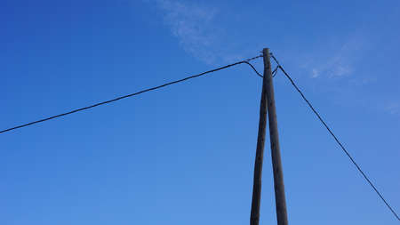 telephone cable tower against blue sky background