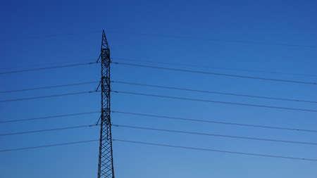 metal electricity tower against blue background Reklamní fotografie