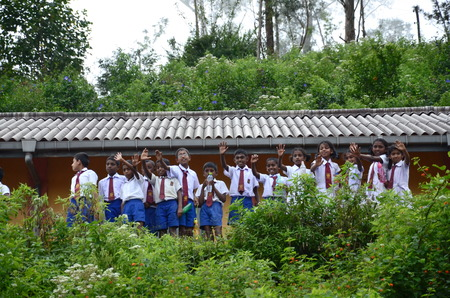 On a train in Sri Lanka - November 22, 2015:  School children waving at passengers on a train passing by their school, an enjoyable almost daily ritual. Editorial