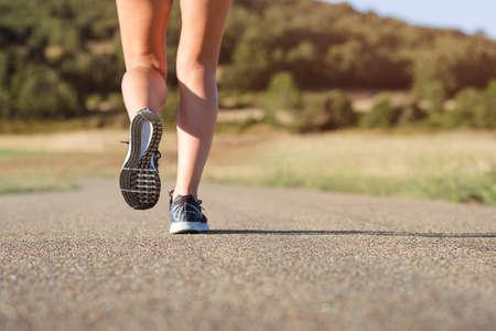 Girl running on the road