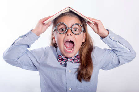 Girl screaming with a book on her head, back to school