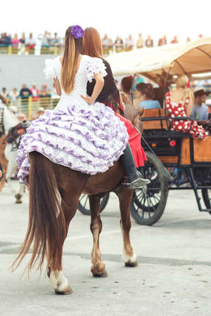 seville: Sevilles April Fair, Spain. Womans riding a horse Stock Photo