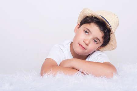 thoughtful child, thinking Little boy lying on bed