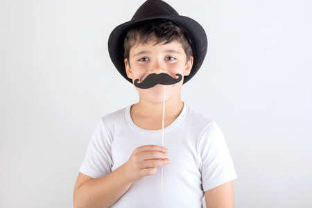 little boy playing with mustache