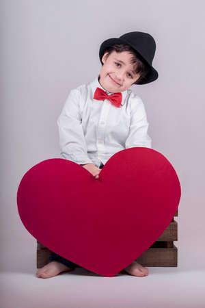 conciliation: happy child with heart Valentines