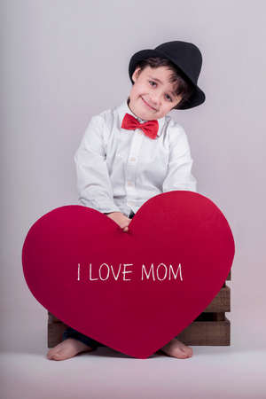 mothering: I love mom. happy child with heart