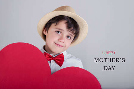 conciliation: Happy Mothers Day. happy child with heart Stock Photo
