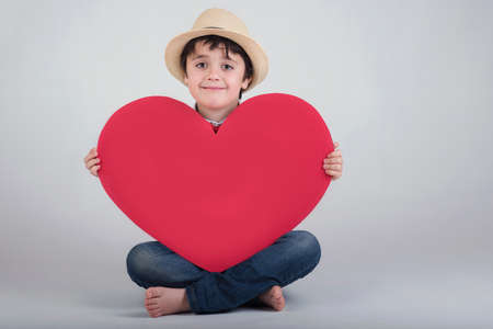 mothering: happy child with heart Valentines
