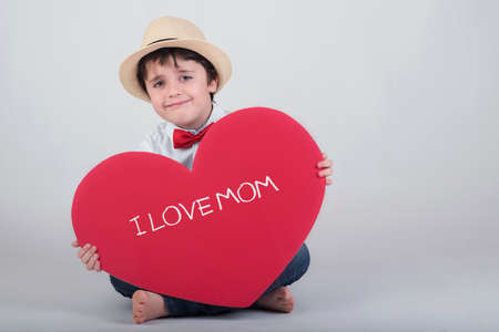 conciliation: I love mom. happy child with heart