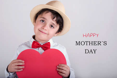mothering: Happy Mothers Day. happy child with heart Stock Photo
