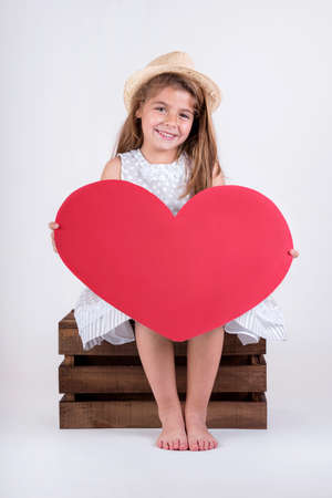 conciliation: happy child laughing girl with heart Valentines