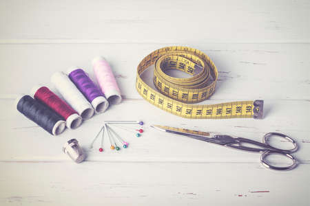 patronage: Sewing accessories on wood table