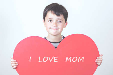 I love mom. happy child with heart
