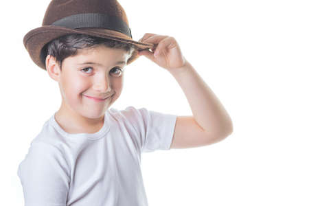 Happy child with hat looks at camera Stock Photo
