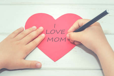 mothering: I love mom.Childrens hands write a heart Stock Photo