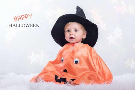 Happy halloween. Baby disguised in halloween