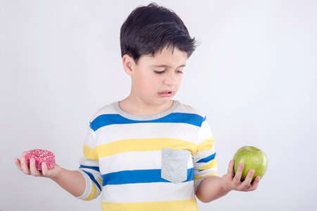 Little boy does not want to eat fruit