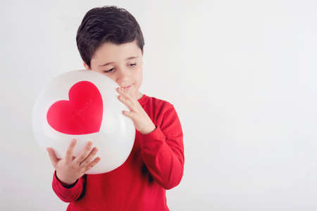 Thoughtful boy with a heart Stock Photo