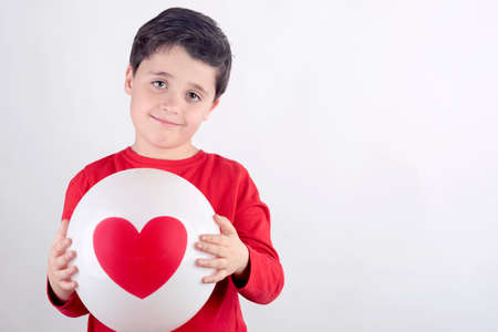 Smiling child with a heart Stock Photo
