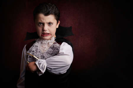 Boy in Halloween. Boy dressed as a vampire. Stock Photo