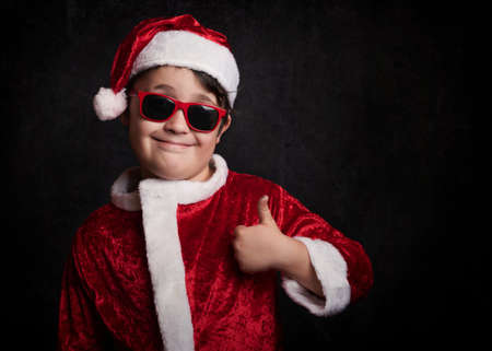 funny boy with sunglasses on christmas