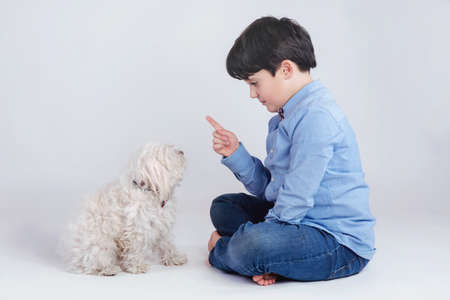 boy sitting with his dog Stock Photo