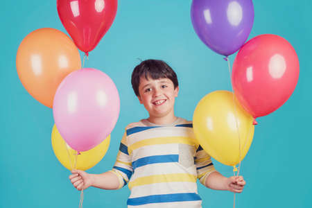 happy and smiling boy with colorful balloon Stock Photo