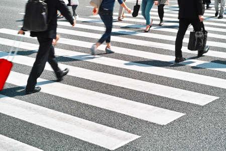 crossing legs: zebra crossing Stock Photo