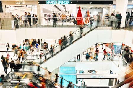 disembarking: HONG KONG - JANUARY 04: People walk through the shopping mall in Shatin New Town Plaza. New Town Plaza is a shopping mall in the town centre of Sha Tin in Hong Kong. Hong Kong January 04, 2014. Editorial