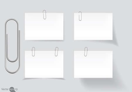 note pad: Paperclip holding a blank paper sheet