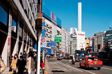 entertainment district: TOKYO JAPAN - December 23, 2014: People walk past Ikebukuro Ikebukuro is a commercial and entertainment district in Toshima, Tokyo, Japan..