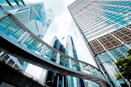 building: Modern glass skyscrapers perspective in the city Stock Photo