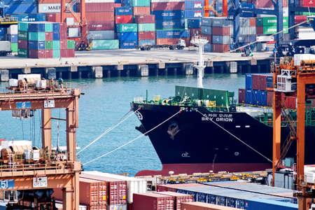 HONG KONG - JUNE 21, 2016: Kwai Tsing Container Terminals is the main port facilities in the reclamation along Rambler Channel between Kwai Chung and Tsing Yi Island, Hong Kong. Editorial