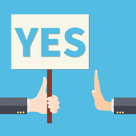 Hand holds YES sign