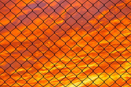 Prison Barbed Wire Fence at Sunset