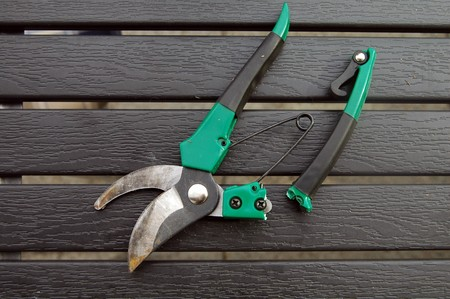 Secateurs with a broken grip on a table