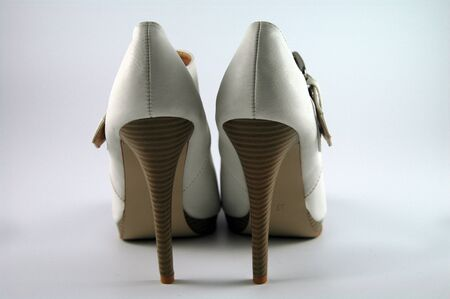 pair of creme-colored high heels with a buckle Stock Photo
